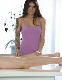 American chick of Asian descent screws a dude after seducing him with a massage
