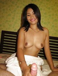 Thai massagist strokes POV hard-on and maze her bare butt too