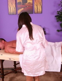 Stripping Asian lady Annie Lee is displaying her knockers while doing rubdown