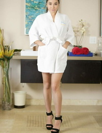 Female massage attendant Karlee Grey doffs her robe and lingerie too