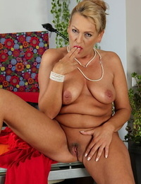 Busty expert chick Andrea lets saggy knockers nut-juice while stroking