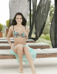 Handsome solo lady Sapphira removing bikini to model naked on outdoor daybed