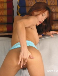 Close up masturbation from an gorgeous Asian accomplished with tight nut sack