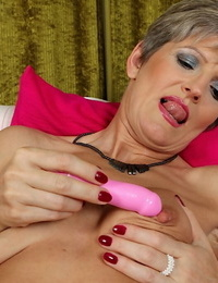 Grey haired granny Melanie uses massager on mature pussy to reach climax