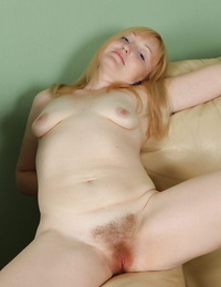 Dirty-minded mature gal uncovering her flabby forms and hairy vag