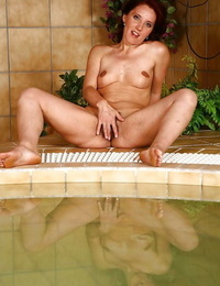 Enthralling mature cockblowers gets rid of her clothes by the pool