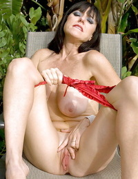 Sexy mature on high high-heeled slippers Karen Kougar denudes her puffy knockers outdoor