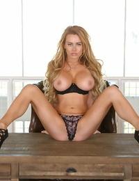 Big-boobed blonde Corinna Blake posing like a hoe in brief mini-skirt and high heels