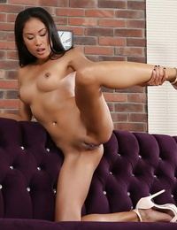 Asian babe fucktoys shaved cunt and ass hole during flashing session