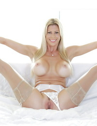 Older ash-blonde solo chick Alexis Fawx unveiling big Mummy boobs and tongues ball-sac