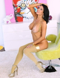 Famous pornstar Veronica Avluv takes off golden lingerie and stockings