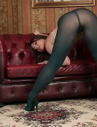 Solo woman Olga Cabaeva rolling down pantyhose to uncover S/M pussy