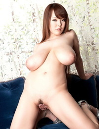 Slurps Asian babe Hitomi fondles her large saggy boobs as she strips