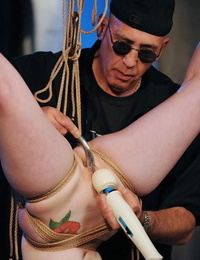 String suspended drool-filled is masturbated upside down until she ejaculations