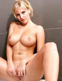 Cikita likes standing nude and posing her vagina and superb tits