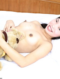Lil\' Asian teenage Diep getting naked on her couch and unveiling her hairy cunt