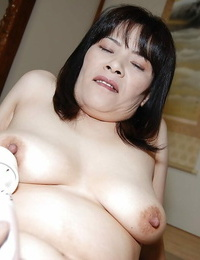 Awesome mature asian with big tits Yumiko masturbatin beaver