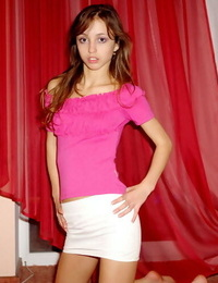 Tiny young woman in short micro-skirt with bare feet flashing white lace subjugation