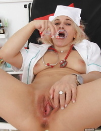 Kinky mature nurse Sandy using expected to spread hairless granny pussy