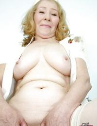 Fatty granny in stockings has no undergarments under her nurse uniform