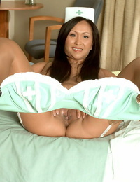 Asian MILF Kitty Langdon shows off on high high-heeled slippers and in stellar underwear