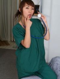 Asian beauty Kuki is demonstrating her bare small bra-stuffers on web cam