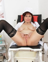 Over 50 nurse Remy opening up stocking dressed gams for finger pounding of bush