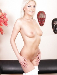 Ash-blonde Alisa A is demonstrating off her spicy tasty nut sack after undressing