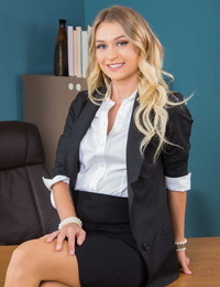 Stellar secretary Natalia Starr strips to pink nylons and garters at work