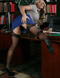 Blond biz woman Alexis Monroe strips to her nylons and garters at work