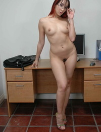 Nerdy Asian lady gives the finger after unclothing nude in office cubicle