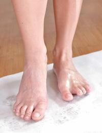 European honey Samanta Blaze displaying lengthy gams and lubricated feet