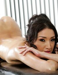 Wonderful Oriental MILF Vicki Pursue plays with her lubricated huge breasts