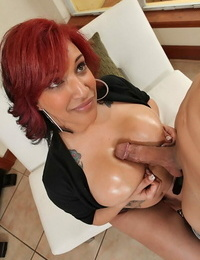 Redhead Plumper seduces and tit fucks her guy with her greased up tits