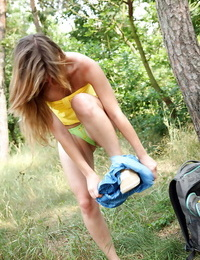 Stunning teenager stunner stripping and finger-tickling her cunt in the woods