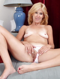 Mature light-haired in blossom undressing and exposing her unshaven honeypot