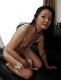 Joyous Asian milf Takako Numai likes showcasing her bushy taco