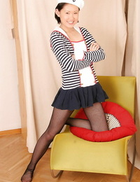 Barely eighteen Asian girl Mai modeling non naked in mesh pantyhose and skirt