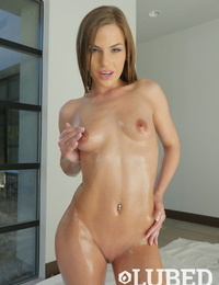 Youthfull solo woman Sydney Cole glazes her scorching bod in oil as she gets nude