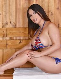 Buxom Asian model Tigerr Benson strutting non naked in bikini