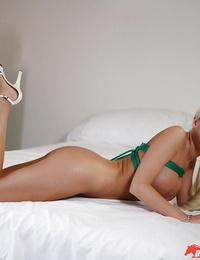 Teenager stunner Britney Amber is showcasing her lubed boobies!