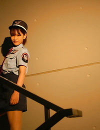 Small asian chick in uniform slowly uncovering her fuckable forms