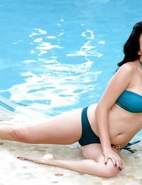 Raw honey Jelena Jensen loosing thick MILF pornstar tits from swimsuit by pool
