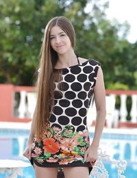 Slim tall European pornstar Leyla Morgan is posing at the poolside