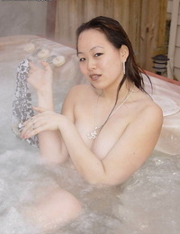 Asian hottie China is taking Jacuzzi and rubbing her cute fuckholes