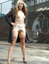 Solo model Jess Wood flashes in a back alley in retro lingerie and nylons