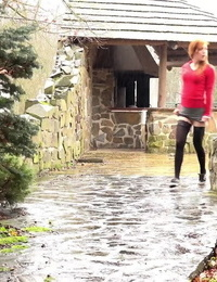 Redhead Sandra lifts her micro-skirt to take a long hot urinate in public