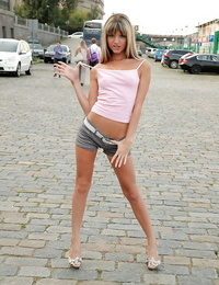 Thin teen in shorts exposing her little boobs in a public place