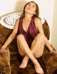 Fledgling Asian solo lady unclothing for opening up of hairy photos