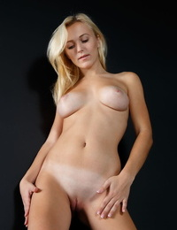Beautiful ash-blonde Aislin stretching naked and flaunting her sexy bare soles